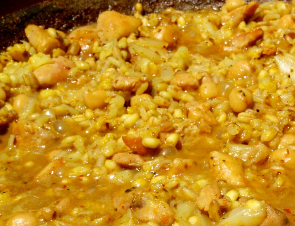 Curry-Ish Chicken and Grains simmering in the paella pan